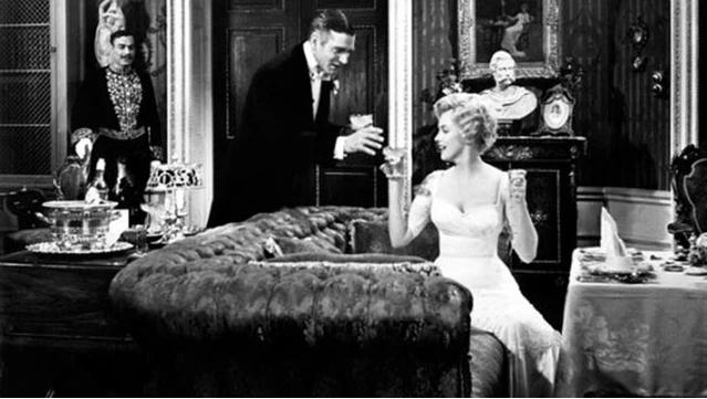 Marilyn Monroe y Laurence Oliver en El Príncipe y la Corista en Sofá Chesterfield